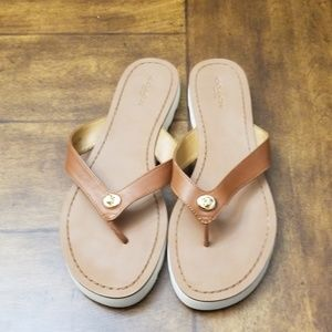 850a4b052fee Coach. Coach brown leather Shelly sandals flip flop gold.  45  80. Size  9  · Coach